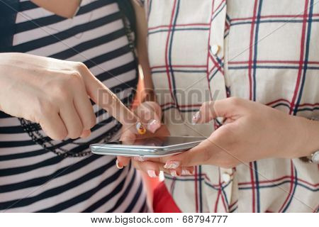 Closeup image of woman using cellphone.