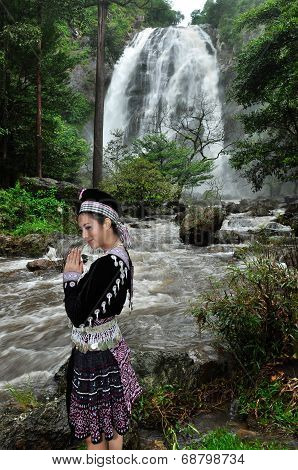 Portrait Of Beautiful Woman Paying Respect To Waterfall