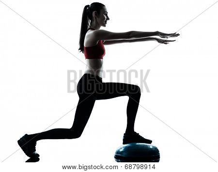 one  woman exercising bosu balance ball trainer in silhouette studio isolated isolated on white background