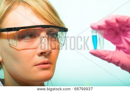 Young beauty girl in the modern laboratory