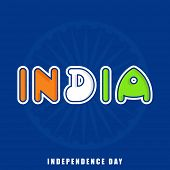 foto of ashoka  - Stylish colorful text India in national flag colors with ashoka wheel on blue background for Independence Day celebrations - JPG