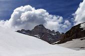 foto of plateau  - Rocks with clouds and snow plateau - JPG