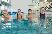 foto of day care center  - Female fitness class doing aqua aerobics in swimming pool at the leisure centre - JPG