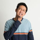 pic of throat  - Asian man sore throat with painful face expression - JPG