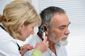 pic of earings  - ENT physician looking into patient - JPG