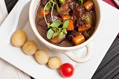 foto of boeuf  - Boeuf bourguignon with carrots onions and mushrooms