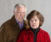 stock photo of sulky  - Pair of serious senior adults in jackets