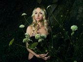 picture of night-blooming  - Twilight portrait of beautiful young lady with bouquet of flowers - JPG