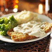 stock photo of southern fried chicken  - country fried steak with southern style peppered milk gravy - JPG