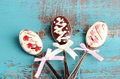 stock photo of chocolate spoon  - Spoons with tasty chocolate for party on old blue wooden table - JPG