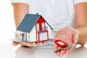 foto of precaution  - a broker for real estate with a house and a key - JPG