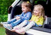 picture of car carrier  - two happy kids in the car spring time - JPG