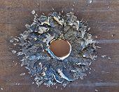 stock photo of gunshot  - Bullet hole on rusty old  iron surface  - JPG