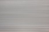stock photo of roller door  - dirty metal roller shutter door as a background - JPG