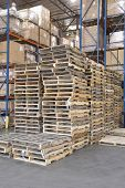 picture of wooden pallet  - Wooden pallets stacked in distribution warehouse - JPG