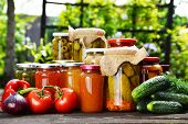 picture of jar jelly  - Jars of pickled vegetables in the garden - JPG