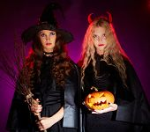pic of antichrist  - Portrait of two sullen females with broom and pumpkin looking at camera - JPG