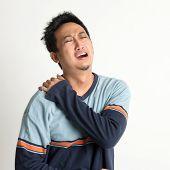 foto of shoulder muscle  - Asian man neck muscle sprain - JPG