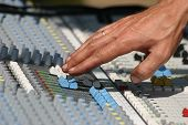 picture of recording studio  - Sound engineer at mixing desk - JPG