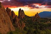 stock photo of god  - Majestic Sunset Image of the Garden of the Gods with dramatic sky - JPG