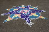 picture of rangoli  - Skillful rangoli handiwork design on floor using colored stone powder - JPG