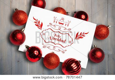 Feliz navidad message against pale grey wooden planks