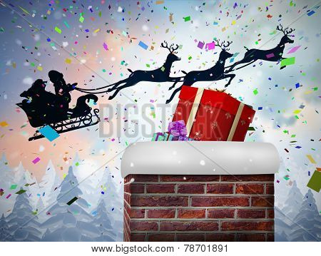 Santa flying his sleigh behind chimney against snow falling on fir tree forest