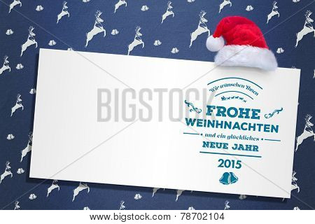 German christmas greeting against blue reindeer pattern