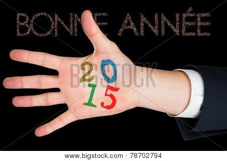 Hand with fingers spread out against glittering bonne annee