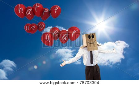 Anonymous businessman with arms out against bright blue sky with clouds