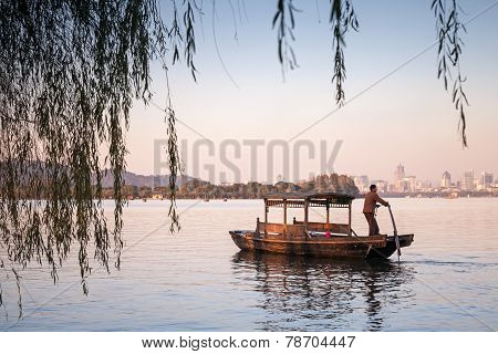 Traditional Chinese Wooden Boat With Boatman