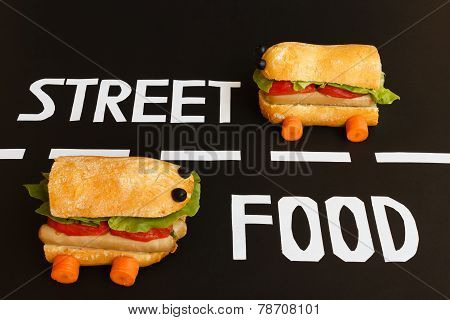 Two Sandwiches   Shaped  Car  Represent The Activity Of Street Food