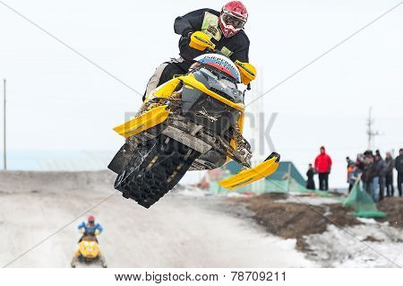 High jump of sportsman on snowmobile