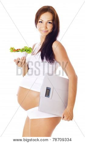 Pregnant Woman Holding Scales And Eating Salad.