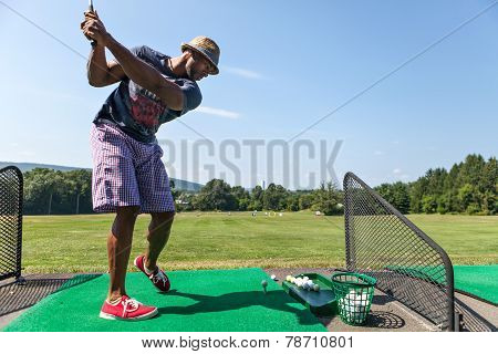 Golfer At The Range