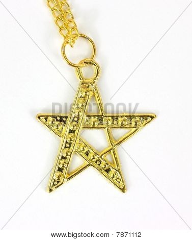 Close view of a gold colored star shaped pendant
