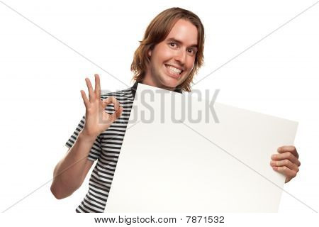 Fun Young Man Holding Blank White Sign