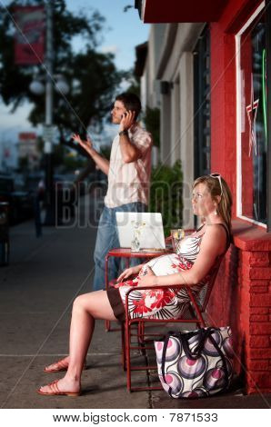 Pregnant Woman Sitting Outside Being Ignored
