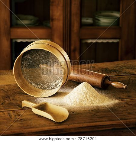 Flour, Wooden Spoon, Wooden Sieve For The Flour, Wooden Roller For Dough