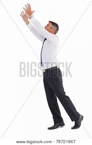Businessman without jacket catching something on white background