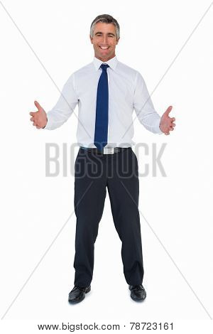 Happy businessman without jacket with arms out on white background