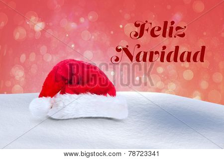 Feliz navidad against red abstract light spot design