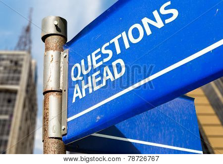 Questions Ahead blue road sign