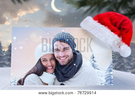 young winter couple against cute christmas village at north pole