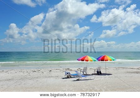 Beach Chairs With Bright Color Umbrellas