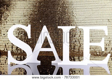 Sale on golden background