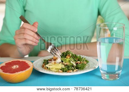 Girl and dietary food at table close-up