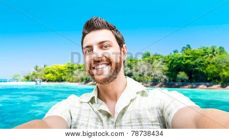 Happy young man taking a selfie photo in Cairns, Australia