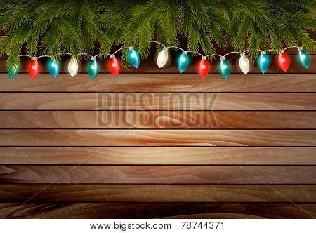 Christmas wooden background with branches and a garland. Vector