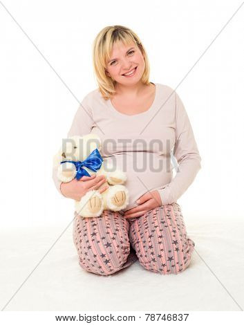 pregnant woman with blue bow on white